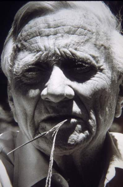 Supreme Court Justice William O. Douglas with straw hanging from his mouth at Goose Prairie in 1972. Black and white.