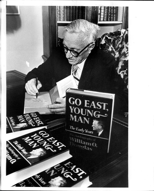 "Supreme Court Justice William O. Douglas at a book signing for his book ""Go East, Young Man"". Black and white"