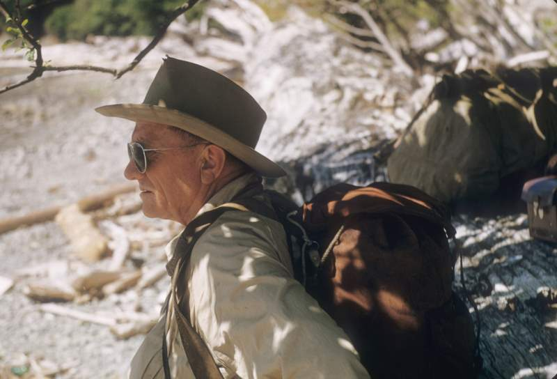Supreme Court Justice William O. Douglas hiking Olympic Beach in Washington state. Color.